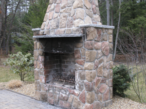Outdoor Fireplace in a Bedford New Hampshire landscape