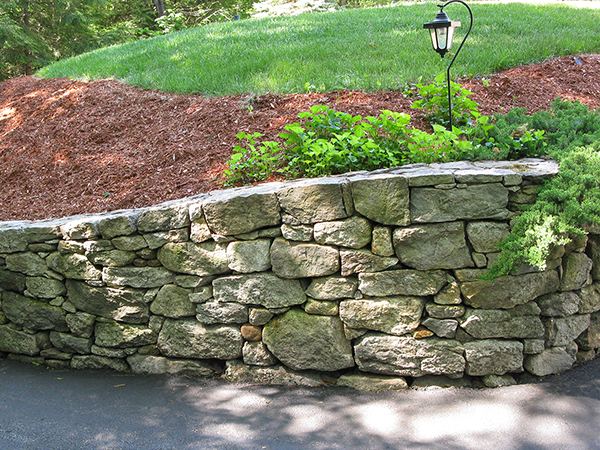 Stone retaining wall along a driveway in New Boston, New Hampshire