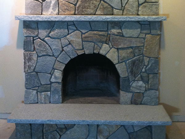 Stone veneer covers a fireplace in Windham New Hampshire