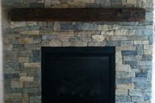 Indoor Fireplace with Stone Veneer for a home in Auburn New Hampshire