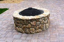 Outdoor fire pit for a Bedford NH patio designed by New England accents