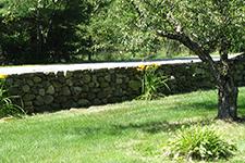 Custom built stone walls in a Hopkinton New Hampshire landscape