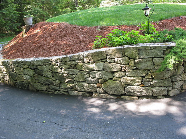 Artistic stone wall in New Boston NH by professional landscape wall builder New England Accents
