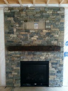 Beautiful granite stone veneer installed on a fireplace in Bedford New Hampshire