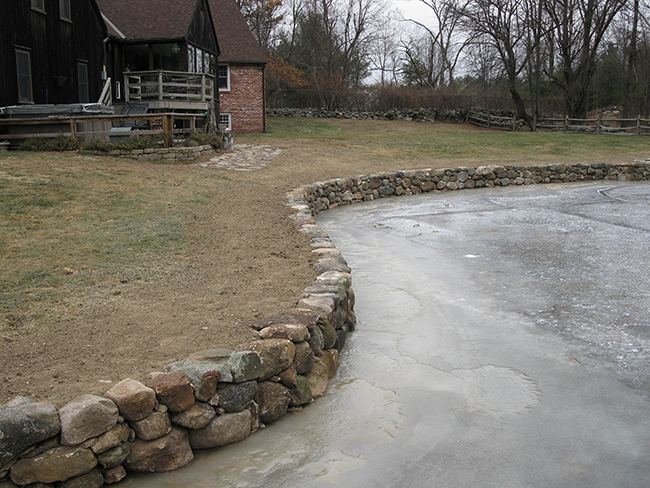 Curving stone wall for a Bedford NH home by stone masons New England Accents