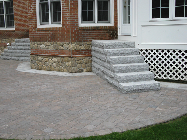 Custom granite stairs installed with a patio for a Bedford NH home
