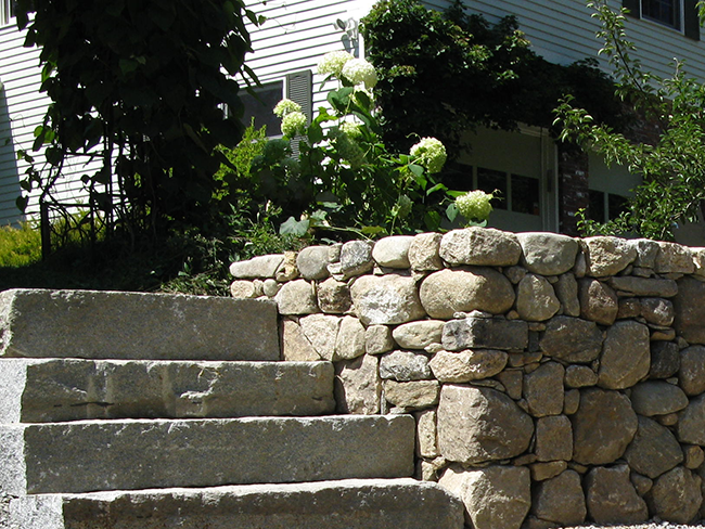 Custom masonry stone wall in Bedford Nh by stone wall installer New England Accents
