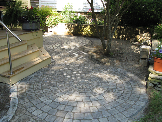 Custom patio for a backyard landscape in Manchester NH