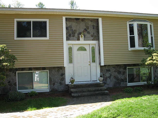 Custom stone veneer installed on the front of this New Boston NH home