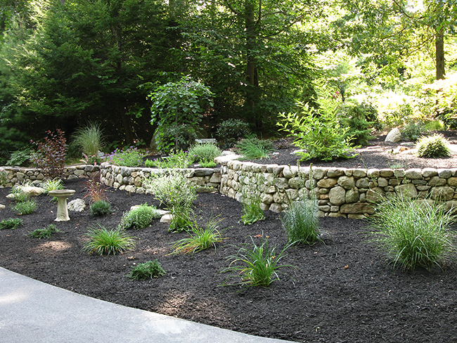 Custom Stone walls in Bedford NH by New England Accents experienced stone wall builders