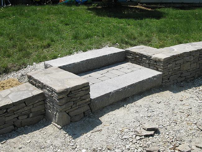 Merrimack NH stone retaining wall with granite steps
