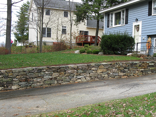 Natural landscaping stone wall in Londonderry New Hampshire