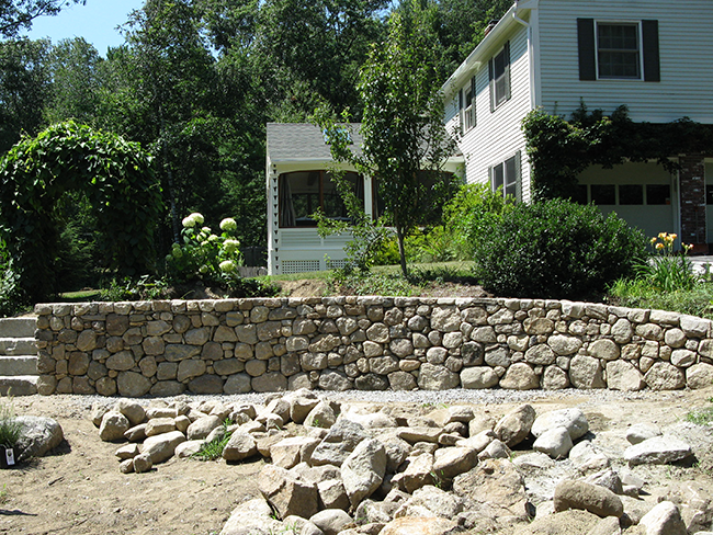 Stone retaining wall in Concord NH landscape