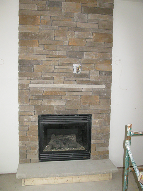 Stone veneer installer customizes fireplace in Auburn New Hampshire