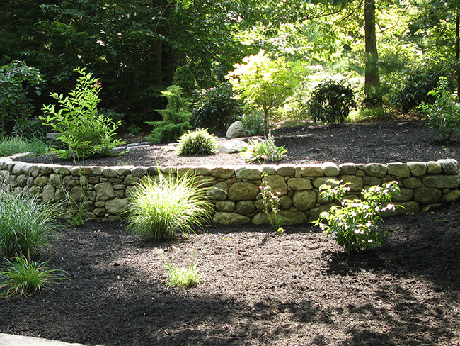 Stone wall and plantings in this Bedford NH landscape