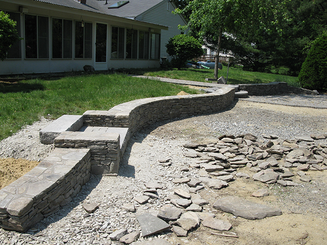 Stone wall with steps in Merrimack NH by stone wall builder New England Accents
