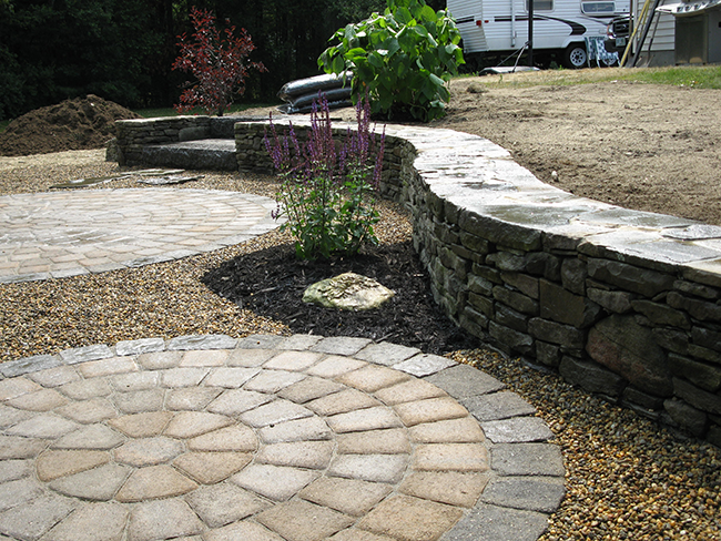 Two circular patios with stone retaining wall in Merrimack NH