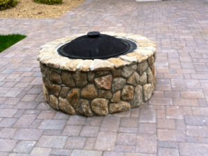 Outdoor fire pit designed and installed by New England Accents for a home in Amherst NH