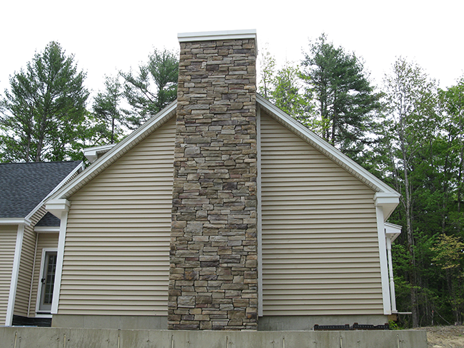 Stone veneer chimney in Bedford NH