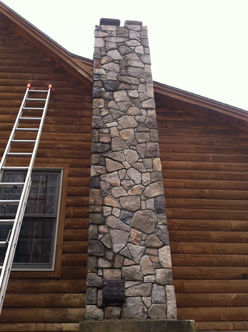 Stone veneer fireplace in Goffstown NH
