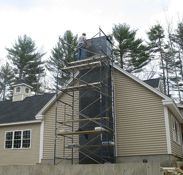 Stone veneer preparation for a chimney in Bedford NH